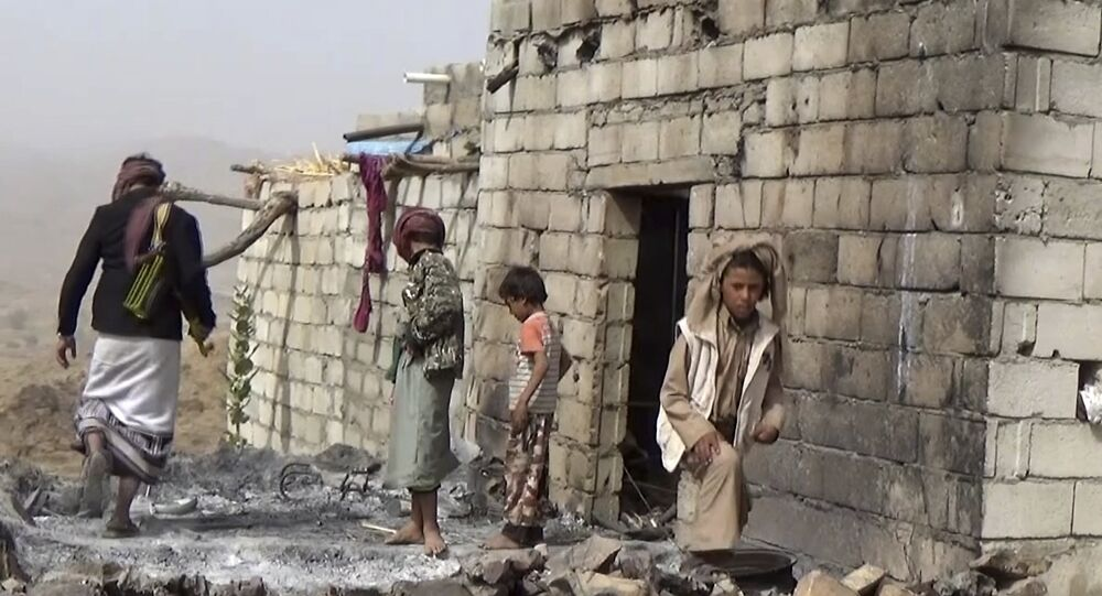 In this February 3, 2017 frame grab from video, residents inspect a house that was damaged during a January 29, 2017 US raid on the tiny village of Yakla, in central Yemen.
