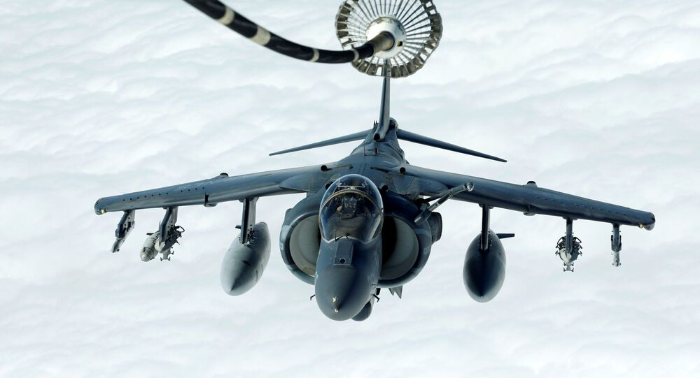 A US Marines Harrier AV-8B makes its way to a fueling boom suspended from a US Air Force KC-10 Extender during mid-air refuelling support to Operation Inherent Resolve over Iraq and Syria air space, March 15, 2017.