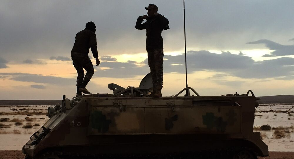 Jordanian soldiers take a break on their armored vehicle (File)