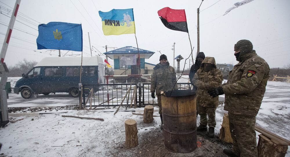 Activists warm themselves at a fire in a camp at Kryvyi Torets station as they take part in a rail blockade that has halted coal supplies in the village of Shcherbivka in Donetsk region, Ukraine, February 14, 2017. Picture taken February 14, 2017