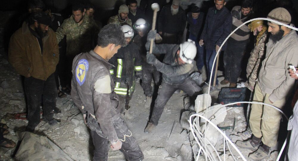 Syrian civil defence volunteers, known as the White Helmets, dig through the rubble of a mosque following a reported airstrike on a mosque in the village of Al-Jineh in Aleppo province late on March 16, 2017