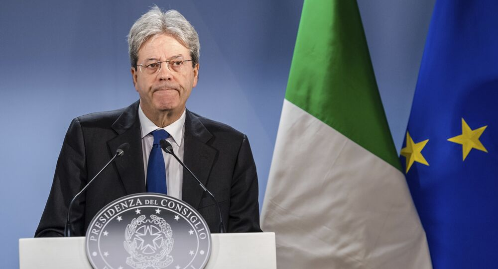 Italian Prime Minister Paolo Gentiloni listens to questions during a media conference at the end of an EU summit in Brussels on Friday, March 10, 2017