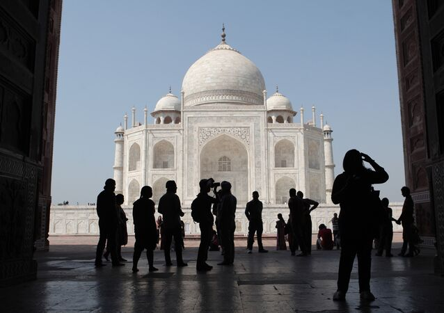 Tourists on the territory of the Taj Mahal palace in the city of Agra