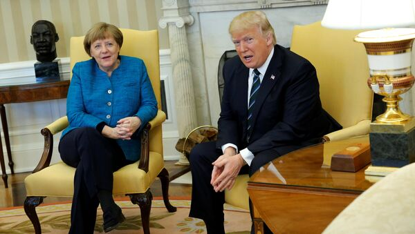 U.S. President Donald Trump and Germany's Chancellor Angela Merkel watch as reporters enter the room before their meeting in the Oval Office at the White House in Washington, U.S. March 17, 2017 - Sputnik International