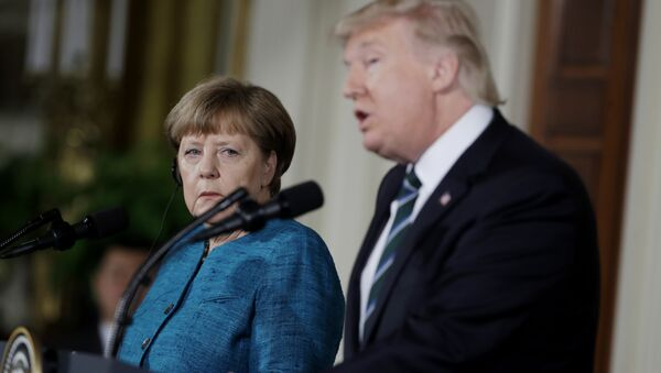 German Chancellor Angela Merkel listens as President Donald Trump speaks during their joint news conference in the East Room of the White House in Washington, Friday, March 17, 2017 - Sputnik International