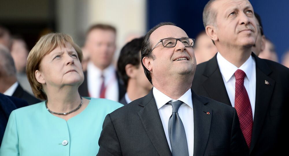 (L-R) German Chancellor Angela Merkel, French President Francois Hollande, and Turkish President Recep Tayyip Erdogan observe the fly-past of NATO countries' jetfighters at the entrance of the National Stadium, the venue of the starting NATO summit, on July 8, 2016