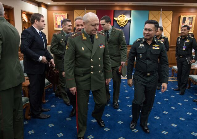 The Commander-in-Chief of the Land Forces of Russia, Colonel General Oleg Salyukov (CL) and Thai General and the Chief of the Thai Armed Forces Surapong Suwana-adth (2nd R) walk together at the end of an official meeting at the Royal Thai Armed Forces Headquarters in Bangkok on March 15, 2017