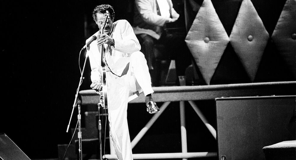 Chuck Berry performs during a concert celebration for his 60th birthday at the Fox Theatre in St. Louis, Mo., Oct. 17, 1986. The concert is being filmed for a motion picture documentary titled Chuck Berry Hail! Hail! Rock 'n' Roll.