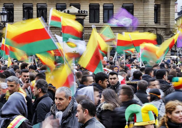 Thousands of Kurds celebrate the Newroz spring festival and protest against Turkish President Erdogan.