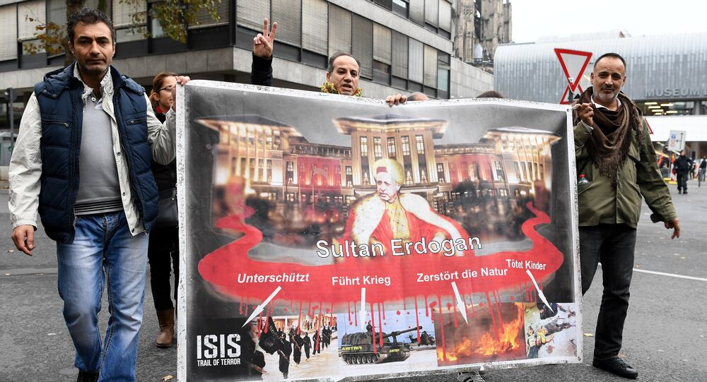 People attend a pro-Kurdish demonstration in Cologne, western Germany, on November 5, 2016 as part of an international day in support to Kurds