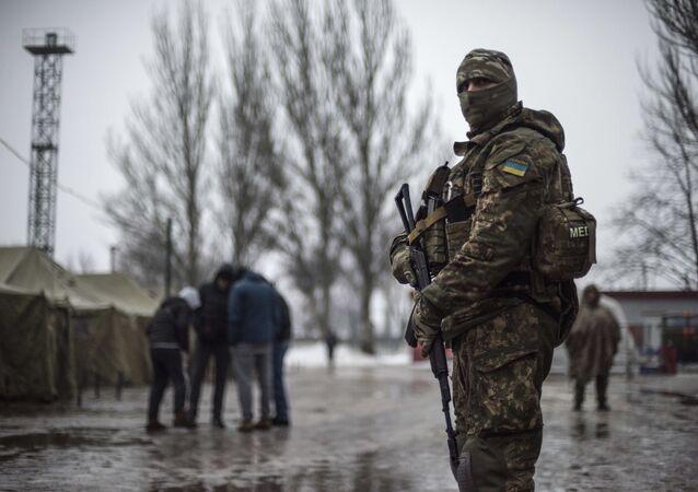 A Ukrainian serviceman patrols at the humanitarian aid center in Avdiivka, Ukraine, Saturday, Feb. 4, 2017