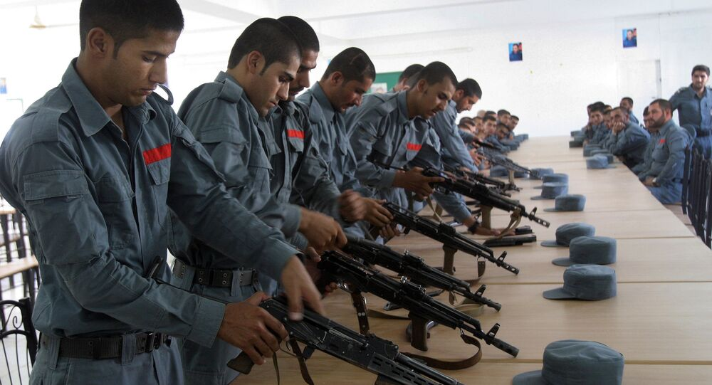 In this July 24, 2016 file photo, Afghan soldiers practice, in Lashkargah, capital of southern Helmand province, Afghanistan