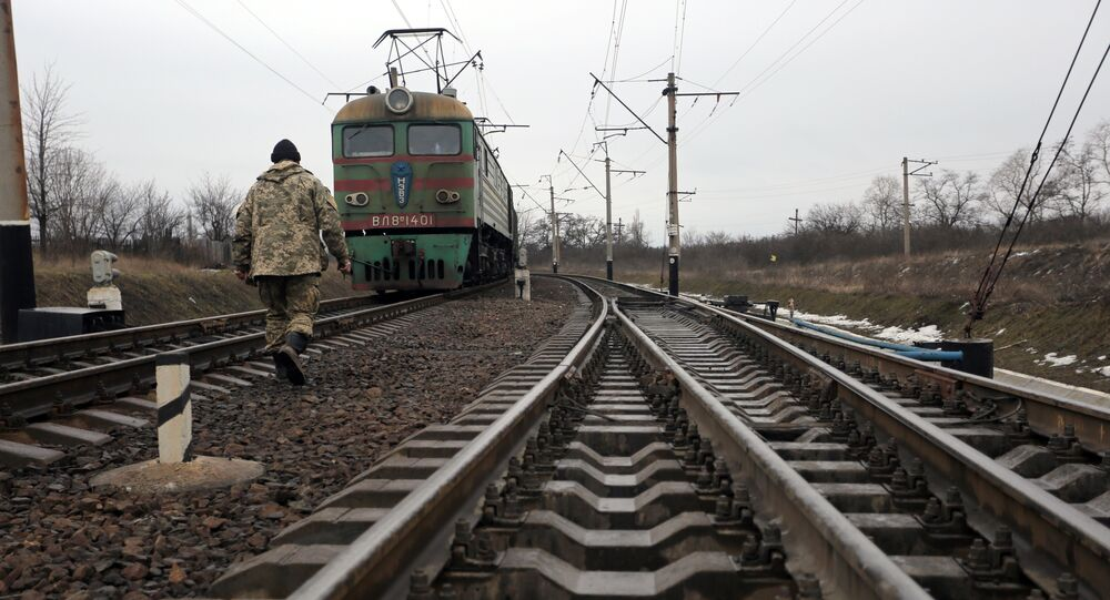 Ukrainian military veteran walks along rails as he takes part in a blockade against ongoing trade with Russian-backed insurgents, on February 23, 2017, in Kryvyi Torets railway station, Donetsk region