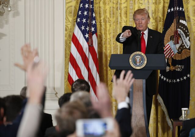 President Donald Trump calls on a reporter during a news conference, Thursday, Feb. 16, 2017, in the East Room of the White House in Washington