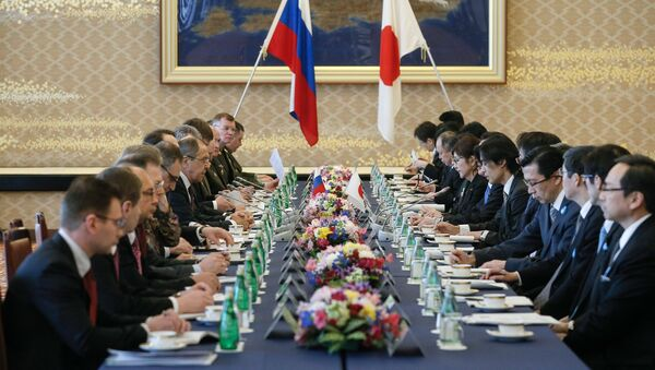 Russian Foreign Minister Sergei Lavrov, center left, and Japanese Defense Minister Tomomi Inada, center right, during two-plus-two talks between defense and foreign ministers of Japan and Russia, in Tokyo. - Sputnik International