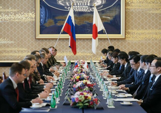 Russian Foreign Minister Sergei Lavrov, center left, and Japanese Defense Minister Tomomi Inada, center right, during two-plus-two talks between defense and foreign ministers of Japan and Russia, in Tokyo.