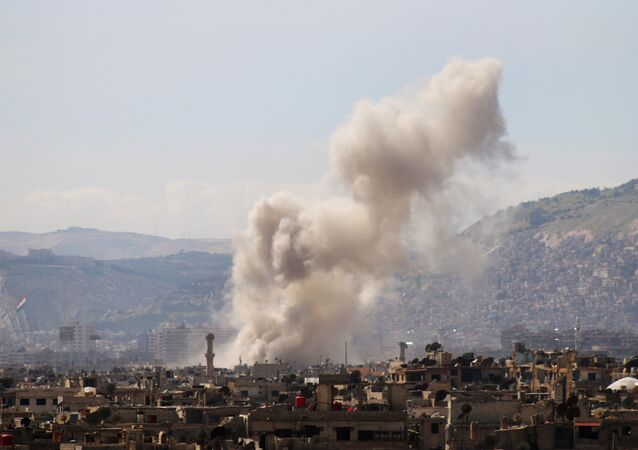 Smoke billows following a reported air strike in the rebel-held parts of the Jobar district, on the eastern outskirts of the Syrian capital Damascus