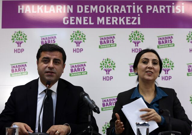 Co-chairmen of pro-Kurdish People's Democratic Party, or HDP, Selahattin Demirtas, left, and Figen Yuksekdag speak to the media in Ankara, Turkey, Sunday, Nov. 1, 2015. Turkey's ruling Justice and Development Party appeared to sweep back into single-party rule after a stunning victory in Sunday's parliamentary election.
