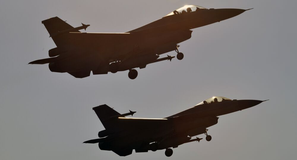 Two US-made F-16 fighters take off from the Chiayi air force base in southern Taiwan during a demonstration on January 26, 2016