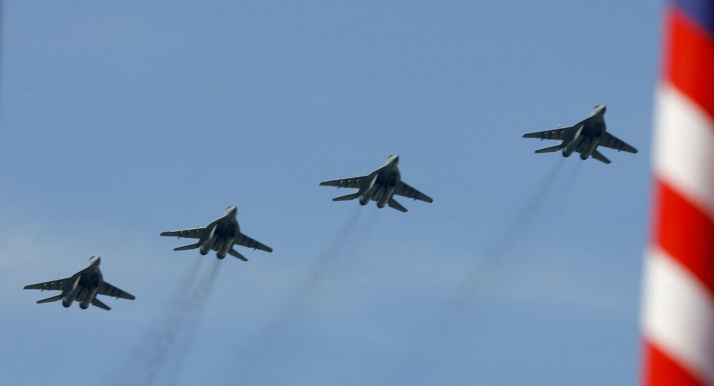 Royal Malaysian Air Force MiG-29 multirole fighters fly in formation over the historic Merdeka Square
