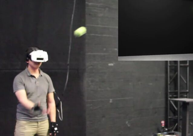 Catching a Real Ball in Virtual Reality