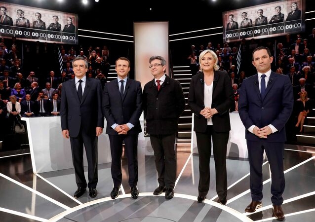 French presidential election candidates (LtoR) Francois Fillon, Emmanuel Macron, Jean-Luc Melenchon, Marine Le Pen and Benoit Hamon, pose before a debate organised by French private TV channel TF1 in Aubervilliers, outside Paris, France