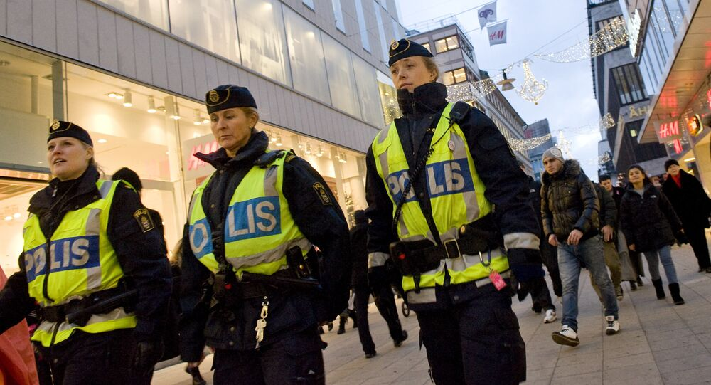 Swedish police officers patrol Drottninggatan street in central Stockholm