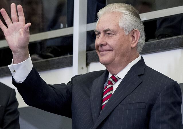 Secretary of State Rex Tillerson waves before speaking to State Department employees upon arrival at the State Department in Washington, Thursday, Feb. 2, 2017