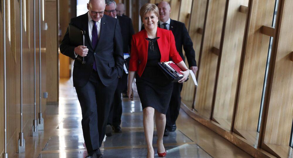 Scotland's First Minister Nicola Sturgeon and Deputy First Minister John Swinney arrive at the Scottish Parliament ahead of a referendum debate in Edinburgh Scotland , Scotland, Britain March 21, 2017.