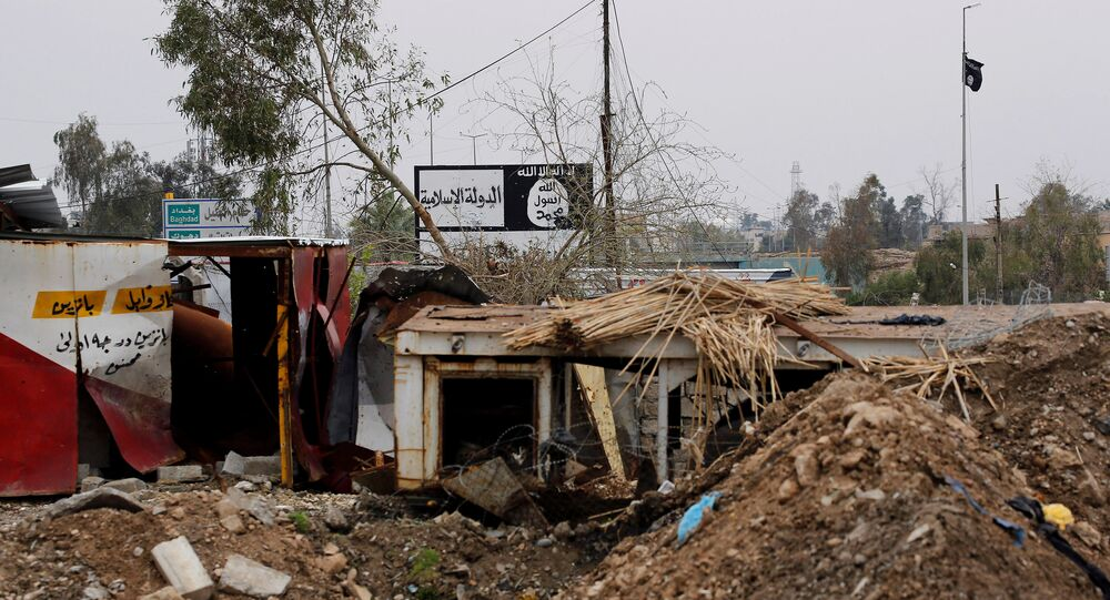 DAESH signs are pictured in Bad el Beid area during a battle between Iraqi forces and DAESH militants, in the city Mosul, Iraq March 18, 2017.