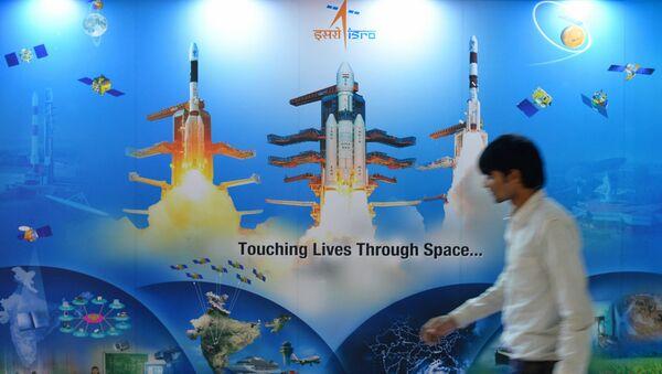 A man walks past a poster of Indian Space Research Organisation (ISRO) - Sputnik International