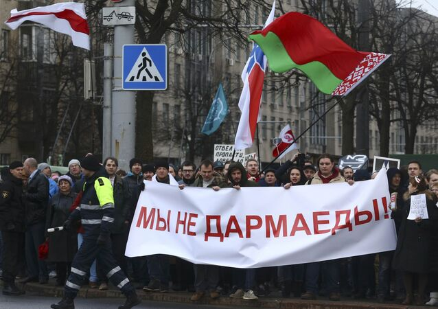 People hold a banner at a protest against increased tariffs for communal services and new taxes, including the tax for those who are not in full-time employment, in Minsk, Belarus March 15, 2017. The banner reads, We are not spongers!