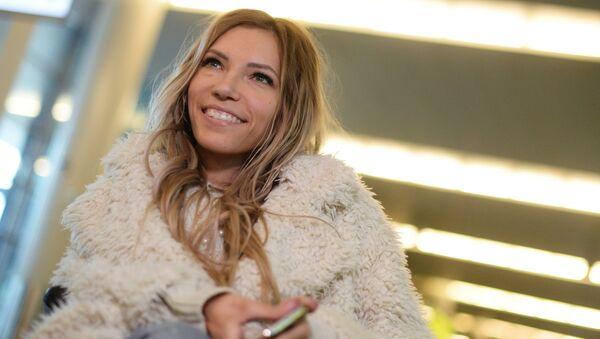 Singer Yulia Samoilova, Russia's representative at Eurovision 2017, at Sheremetyevo International Airport - Sputnik International