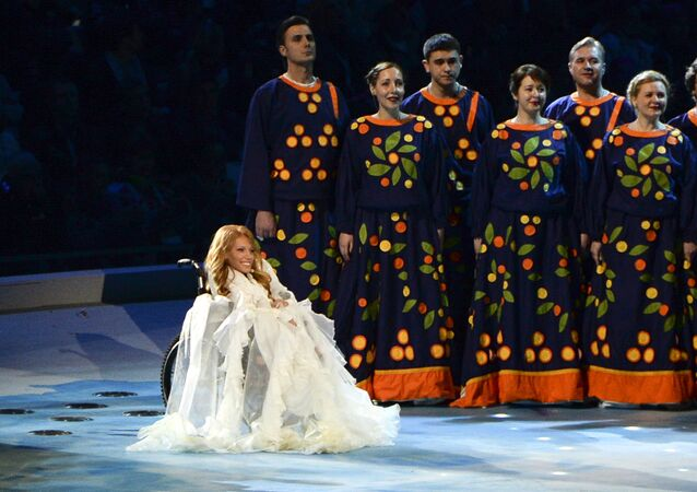 FILE In this Friday, March 7, 2014 file photo, Yulia Samoylova sits on stage during the opening ceremony of the 2014 Paralympic Games in Sochi, Russia.