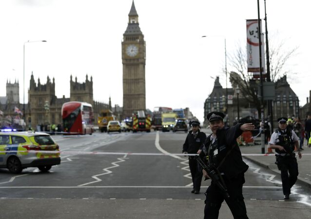 Police secure the area on the south side of Westminster Bridge close to the Houses of Parliament in London