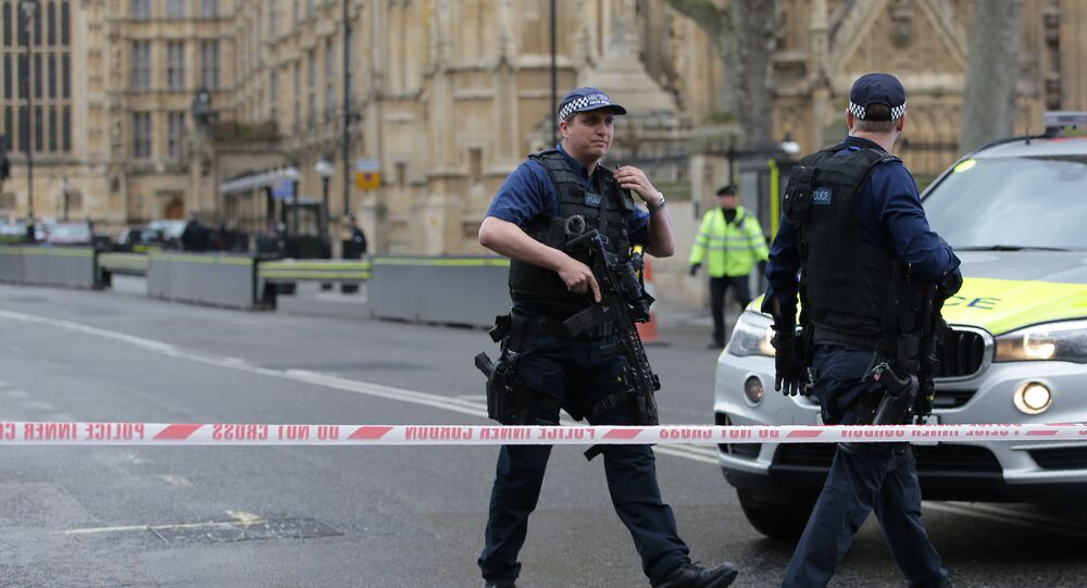 Armed police officers guard at a police cordon outside the Houses of Parliament in central London on March 22, 2017 during an emergency incident