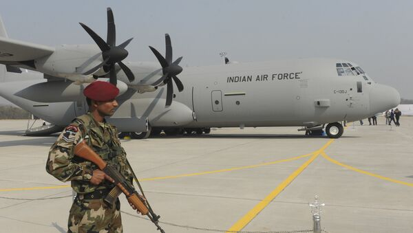 An Indian soldier stands guard in front of the first of the six C-130J Super Hercules, a US military aircraft manufactured by Lockheed Martin. (File) - Sputnik International