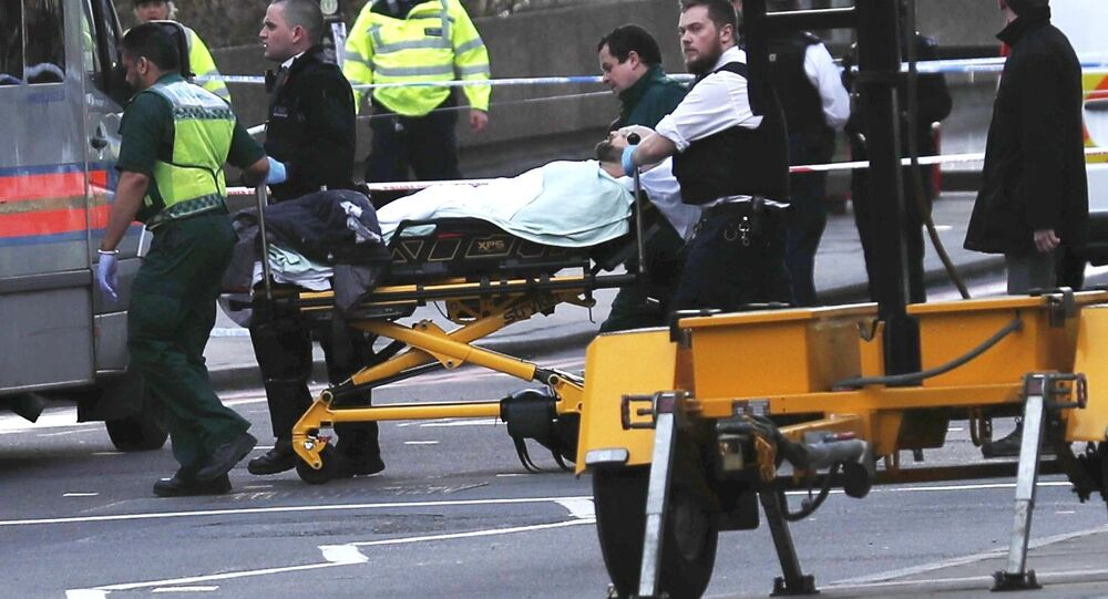 Members of the emergency services take an injured person away on a stretcher after an incident on Westminster Bridge in London, Britain