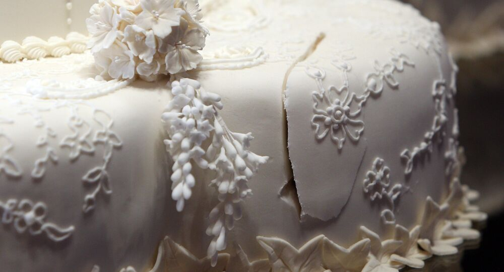 The royal wedding cake, showing the first cut made by the Duke and Duchess of Cambridge, is seen in Buckingham Palace, London, Wednesday July 20, 2011, before going on display to the public during the palace's annual summer opening.