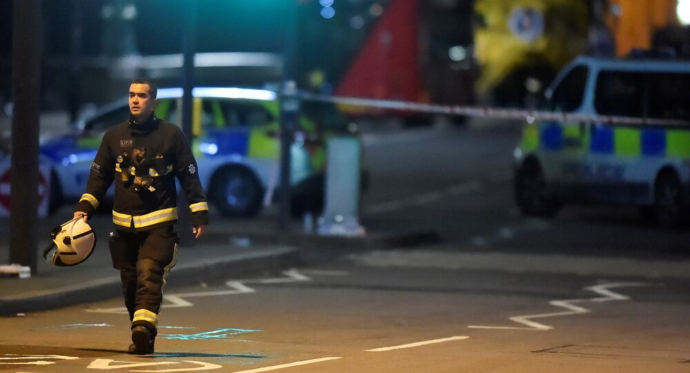 A fire officer works at the scene after an attack on Westminster Bridge in London, Britain, March 22, 2017.