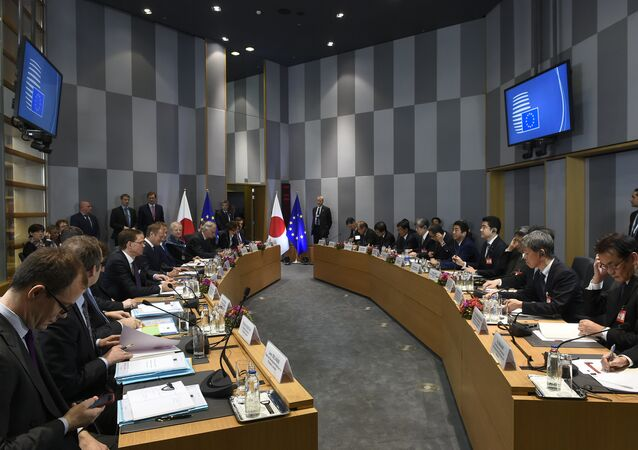 Officials sit as they attend an EU-Japan summit with EU Commission President, European Council and Japan's Prime Minister at the EU Headquarters in Brussels on March 21, 2017.