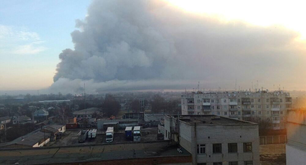Smoke rises over a warehouse storing tank ammunition at a military base in the town of Balaklia (Balakleya), Kharkiv region, Ukraine