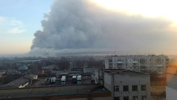 Smoke rises over a warehouse storing tank ammunition at a military base in the town of Balaklia (Balakleya), Kharkiv region, Ukraine - Sputnik International