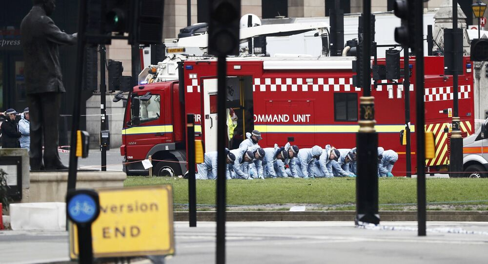 Police officers search an area of Parliament Square the morning after an attack in London, Britain, March 23, 2017.