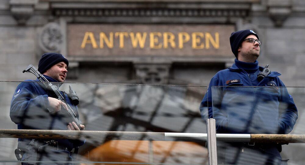 Belgian police officers patrol in the central station, in Antwerp, Belgium