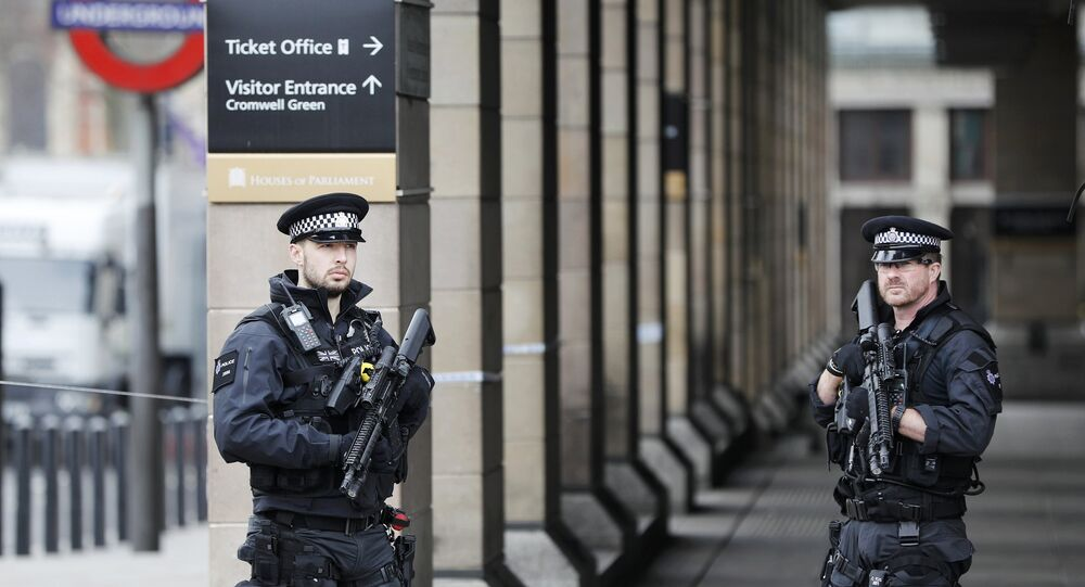 Armed police officers patrol outside Westminster underground station the morning after an attack in London, Britain, March 23, 2017.