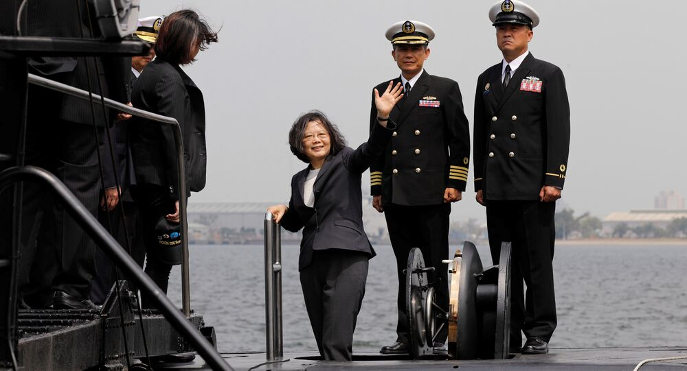 Taiwan President Tsai Ing-wen waves as she boards Hai Lung-class submarine (SS-794) during her visit to a navy base in Kaohsiung, Taiwan March 21, 2017.