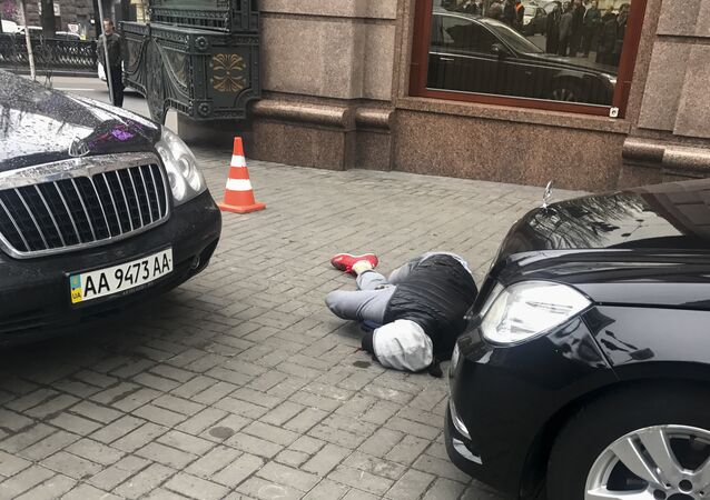 An assassin, who shot and killed Denis Voronenkov, lies wounded in Kiev, Ukraine