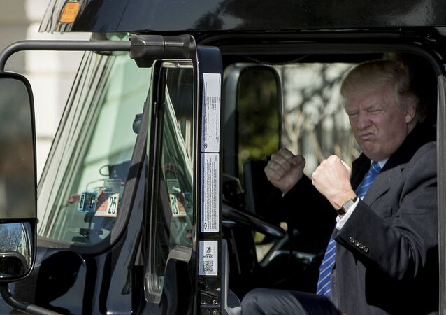 President Donald Trump gestures while sitting in an 18-wheeler truck while meeting with truckers and CEOs regarding healthcare on the South Lawn of the White House in Washington, Thursday, March 23, 2017.