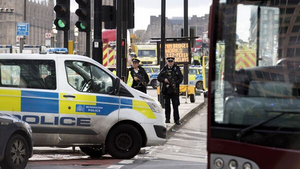 Police officers cordon off the territory near the UK Parliament in London where an assailant attacked a police officer and pedestrians. - Sputnik International